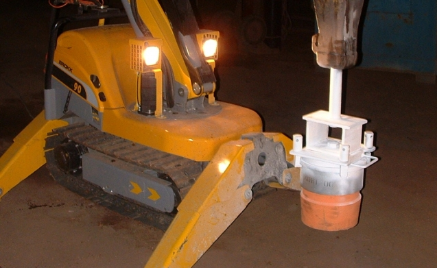 Adaption of remote demolition machine to install steel ladle plugs during emergencies.